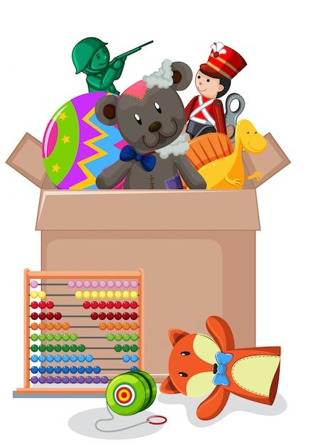 Kartonnen doos vol speelgoed Gratis Vector