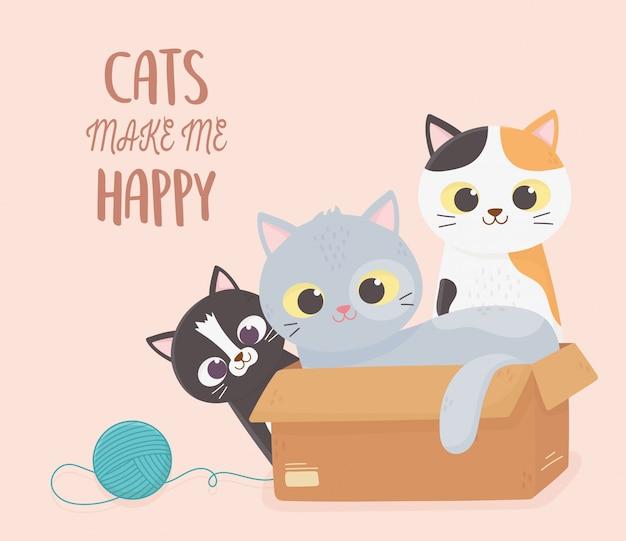 Katten huisdier maken me blij poesjes met kartonnen doos en wol bal cartoon afbeelding Premium Vector