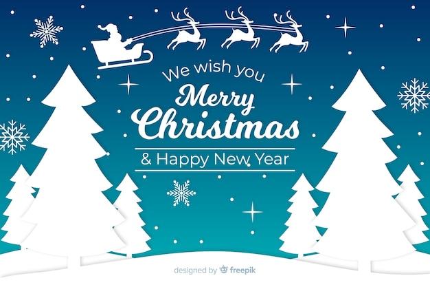 Kerst achtergrond in papier stijl Gratis Vector