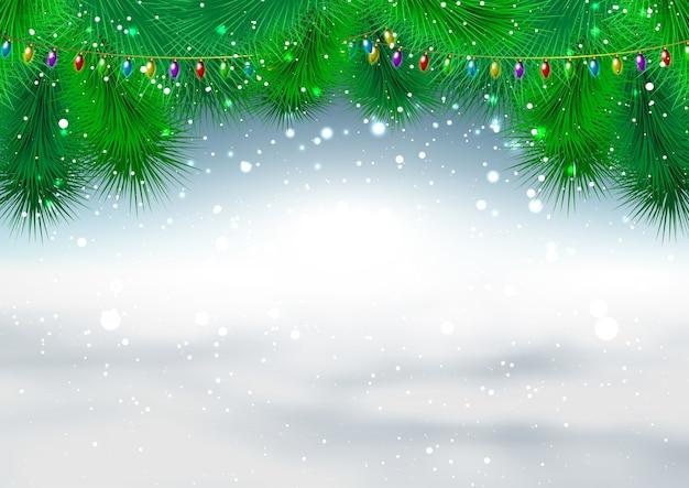 Kerst achtergrond met fir tree takken en sneeuwvlokken Gratis Vector