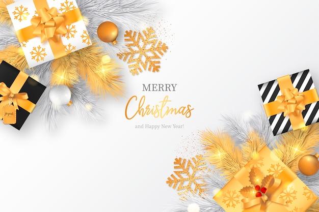 Kerst achtergrond met gouden presenteert en decoratie Gratis Vector