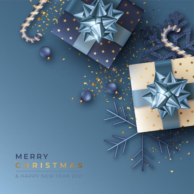 Kerst achtergrond met realistische cadeautjes Gratis Vector