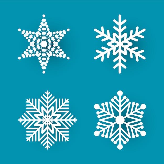 Kerst papier gesneden vier witte sneeuwvlokken Premium Vector