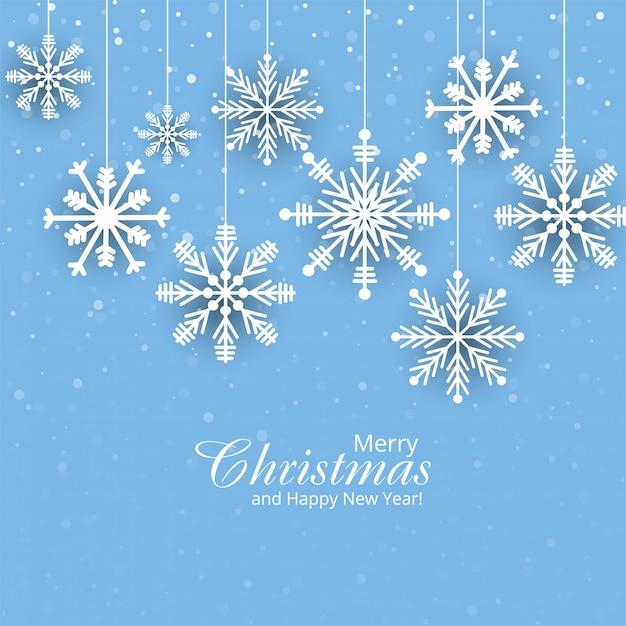 Kerst papieren kaart met hangende sneeuwvlokken achtergrond Gratis Vector