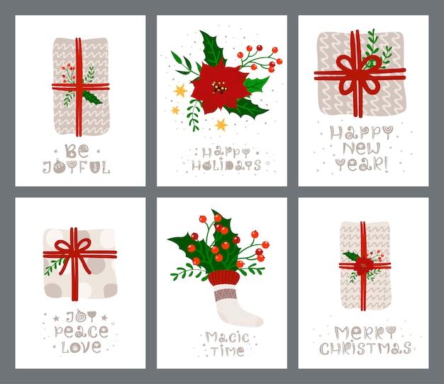 Kerst set wenskaart met cadeau en belettering. Premium Vector