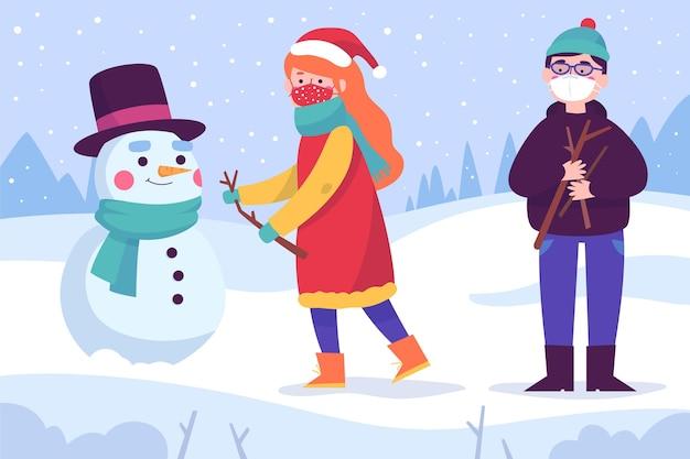 Kerst sneeuwscène met maskers Gratis Vector
