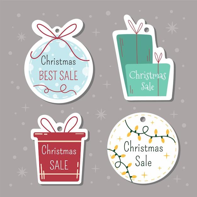 Kerst tags met letters en met de hand getekende elementen Gratis Vector
