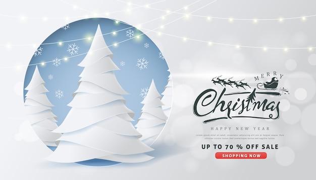 Kerst verkoop banner met kalligrafische kerst belettering en kerstman slee rendieren Premium Vector