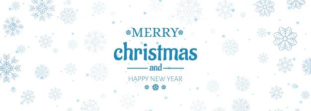 Kerst website banner met decoratiesneeuwvlokken Gratis Vector