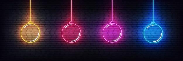 Kerstbal neon elementen. reeks realistische kleurrijke gloeiende teken van kerstmisdecoratie Premium Vector