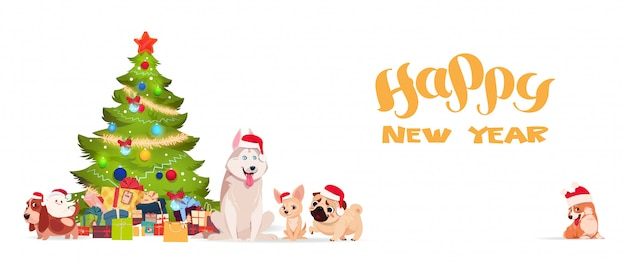 Kerstboom en schattige honden in santa hoeden op witte achtergrond gelukkig nieuwjaar banner vakantie gr Premium Vector