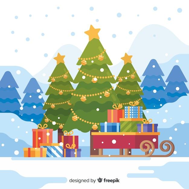 Kerstboomachtergrond met cadeaus en een slee Gratis Vector