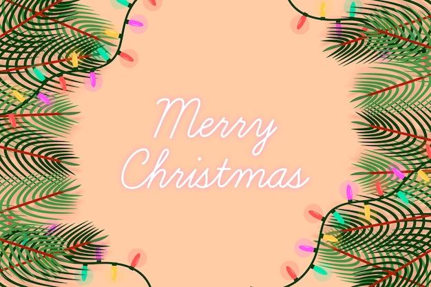 Kerstboomtakken en lichtslingers Gratis Vector