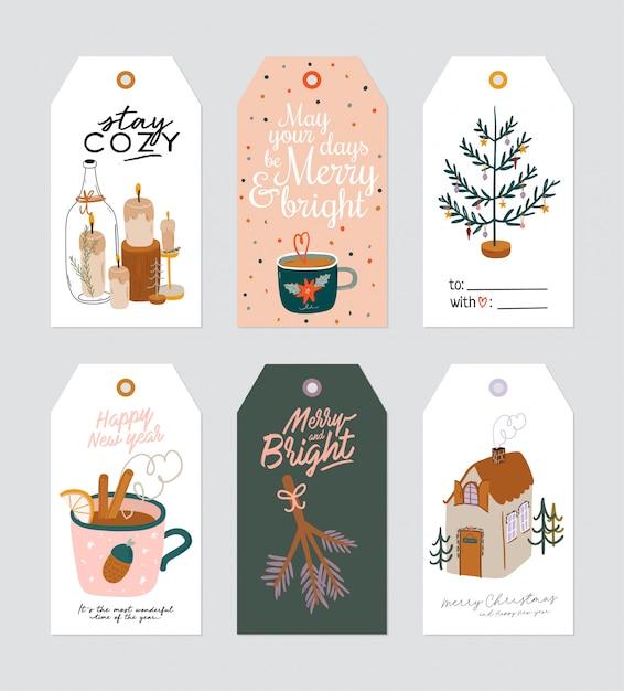 Kerstcadeaukaartje met schattige hygge-ilustration en wensen voor vakantiebelettering. afdrukbare handgetekende kaarten sjablonen. seizoensgebonden labels. . set Premium Vector