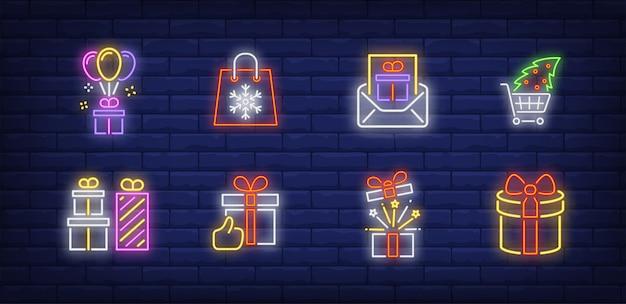 Kerstcadeautjes symbolen in neonstijl Gratis Vector