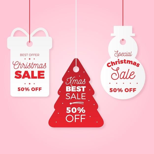 Kerstcollectie tagverkoop in papieren stijl Gratis Vector
