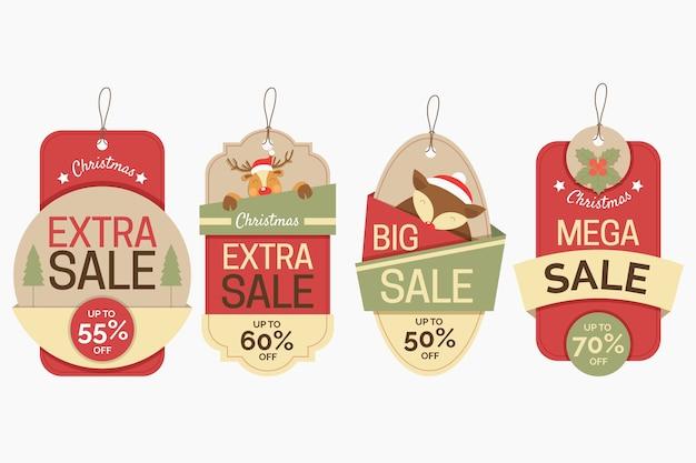 Kerstcollectie tagverkoop in papierstijl Gratis Vector