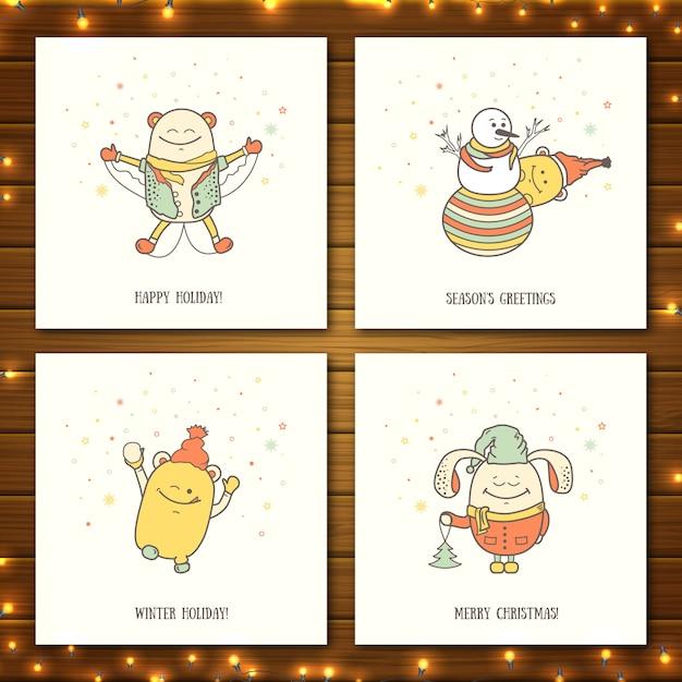 Kerstgroetkaarten met schattige monsters. cartoon personages spelen en entertainment winter Premium Vector