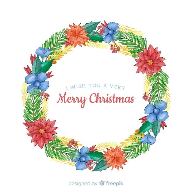 Kerstkrans met prachtige blauwe bloemen Gratis Vector