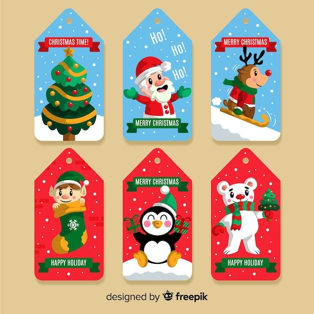 Kerstlabelcollectie in plat ontwerp Gratis Vector