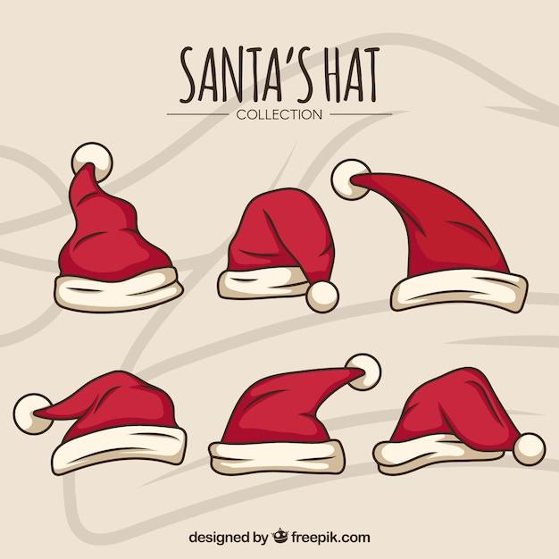 Kerstman hoed cartoon set Gratis Vector