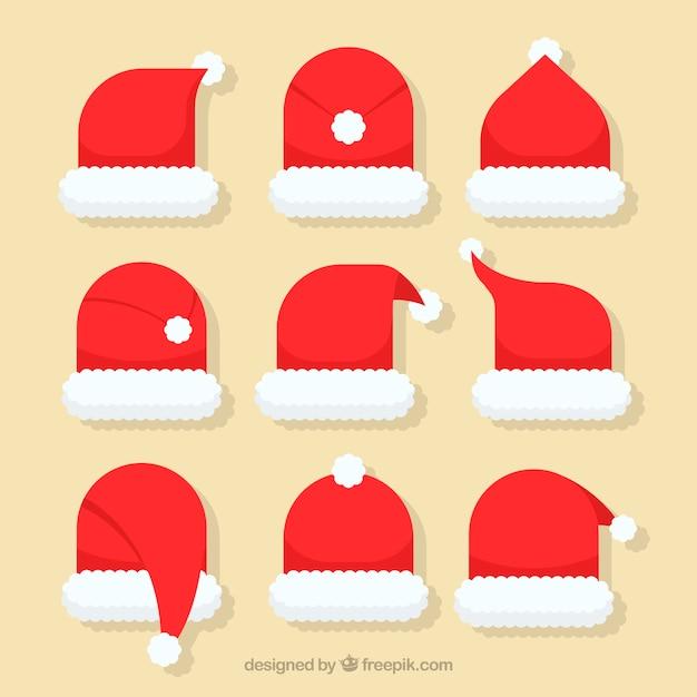 Kerstman hoed collectie in plat ontwerp Gratis Vector
