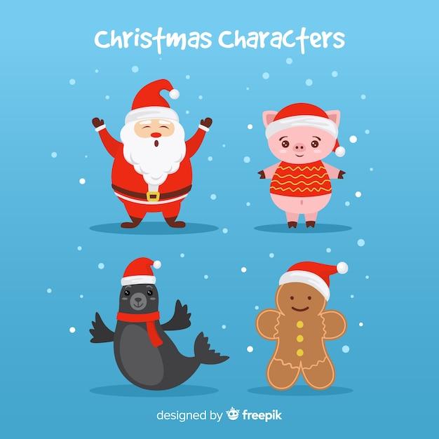 Kerstman met schattige dieren en peperkoek karakters Gratis Vector