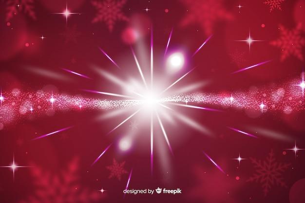 Kerstmis fonkelende achtergrond en sterren Gratis Vector