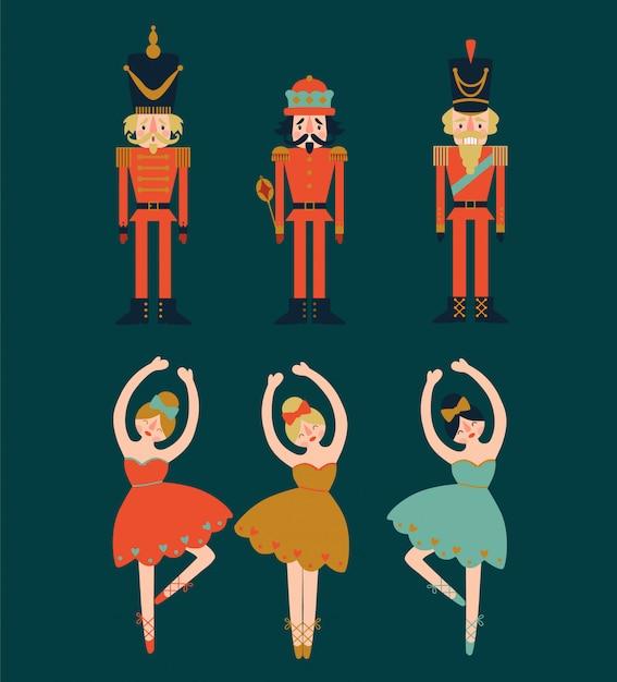 Kerstmis met notekrakers en ballerina's op blauwe achtergrond wordt geplaatst die. Premium Vector
