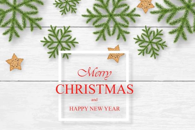 Kerstmis op witte houten achtergrond met wensen Premium Vector