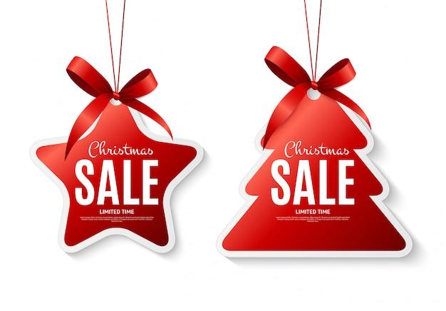 Kerstmis verkoop etiketten met strik Premium Vector