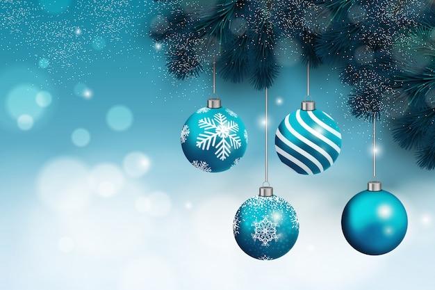 Kerstmisachtergrond met blauwe kerstmisballen en sneeuw Premium Vector