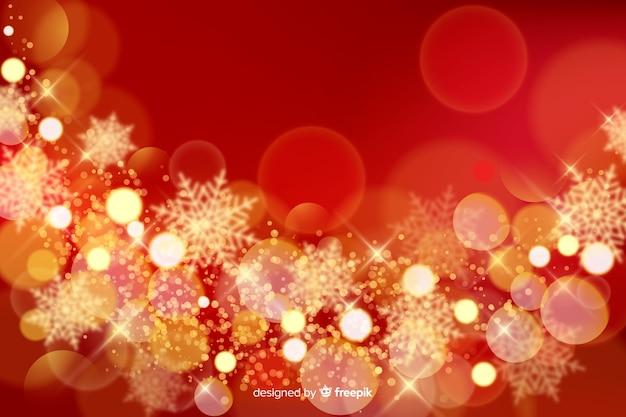 Kerstmisachtergrond met fonkelingen Gratis Vector