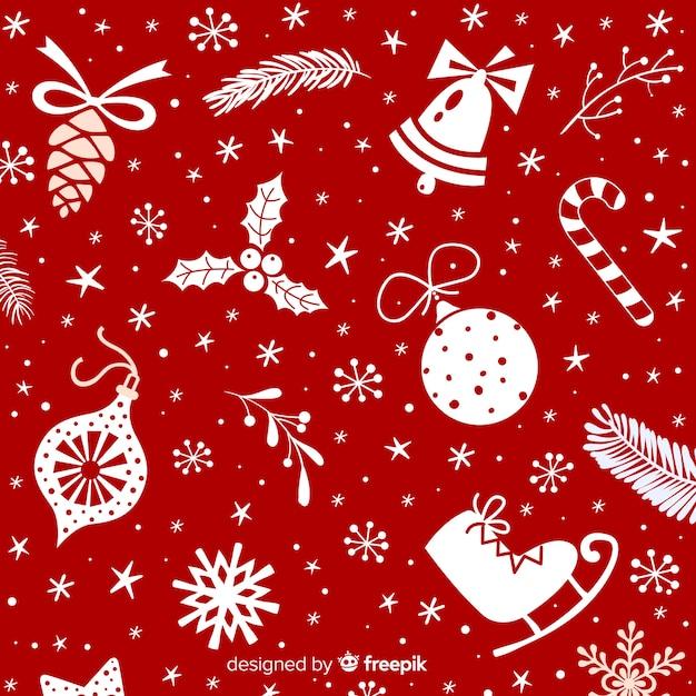 Kerstmisachtergrond met verschillende decoratie Gratis Vector