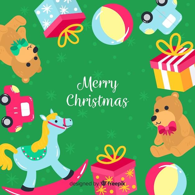 Kerstmisachtergrond van het speelgoedkader Gratis Vector