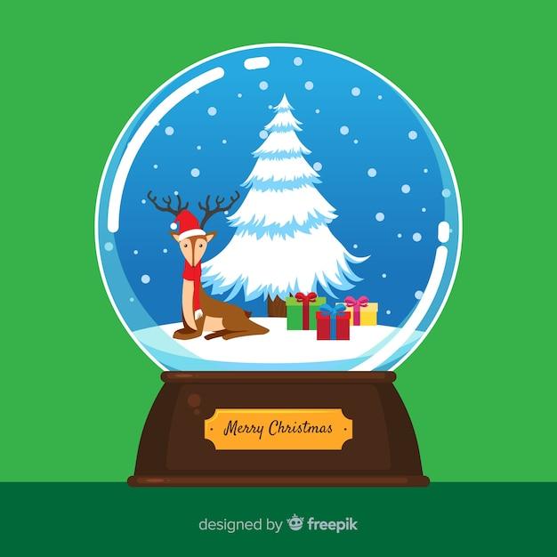 Kerstmissneeuwbal met rendier Gratis Vector