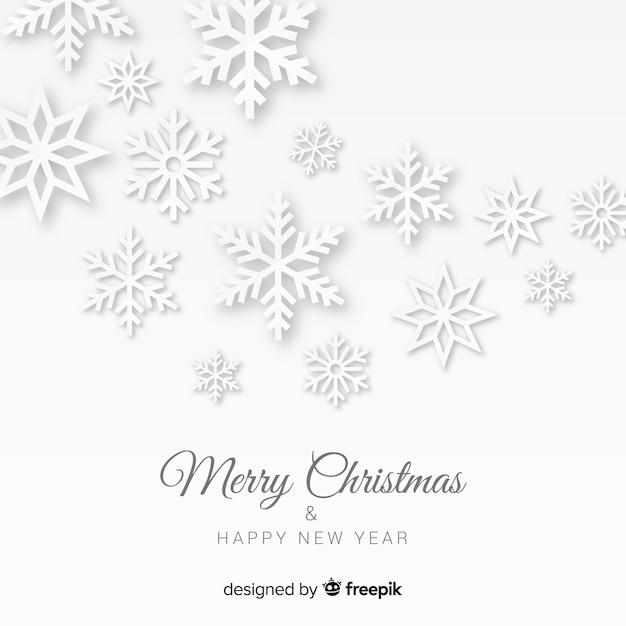 Kerstmissneeuwvlokken in papierstijl Gratis Vector