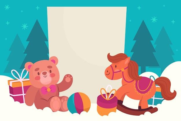 Kerstmisspeelgoed met lege banner Gratis Vector