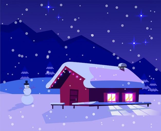 Kerstnacht besneeuwd landschap met een klein huis met verlichtingsvensters versierd met een slinger en een sneeuwpop. Premium Vector