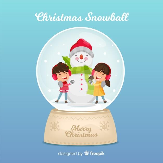 Kerstsneeuwbal met kinderen Gratis Vector