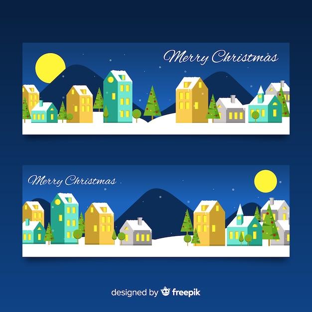 Kerststad banners met platte ontwerp Gratis Vector