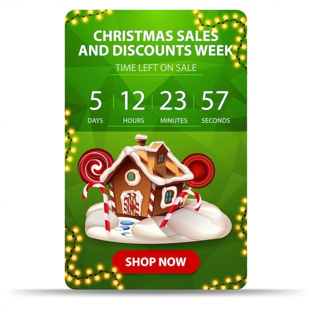 Kerstverkoop en kortingsweek, groene kortingsbanner met countdown, slinger, knop en kerstpeperkoekhuis Premium Vector