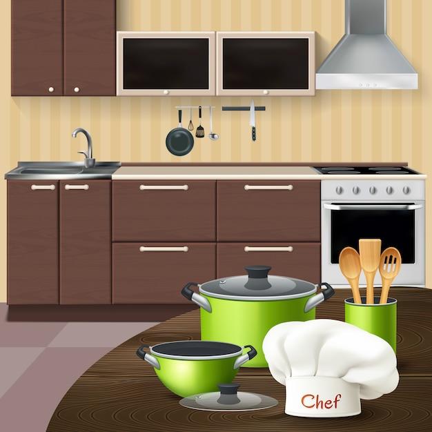 Keukenbinnenland met realistische groene cookware houten hulpmiddelen en chef-kokhoed op bruine lijstillustratie Gratis Vector