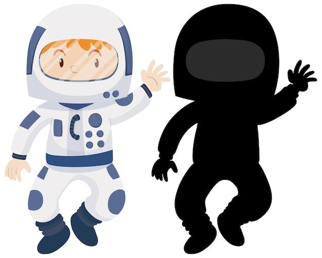 Kind draagt astronaut kostuum met zijn silhouet Gratis Vector