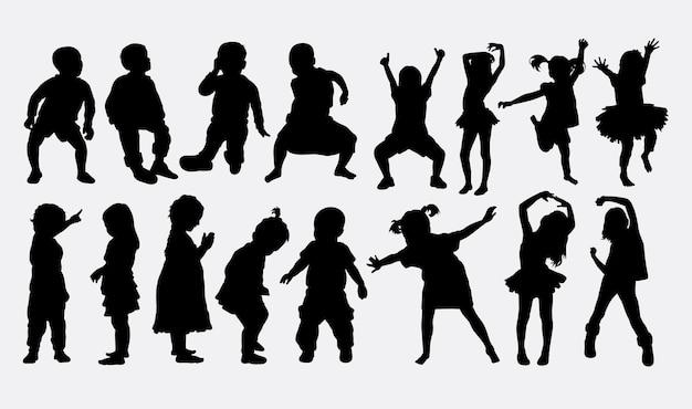 Kinderen dansen silhouet Premium Vector