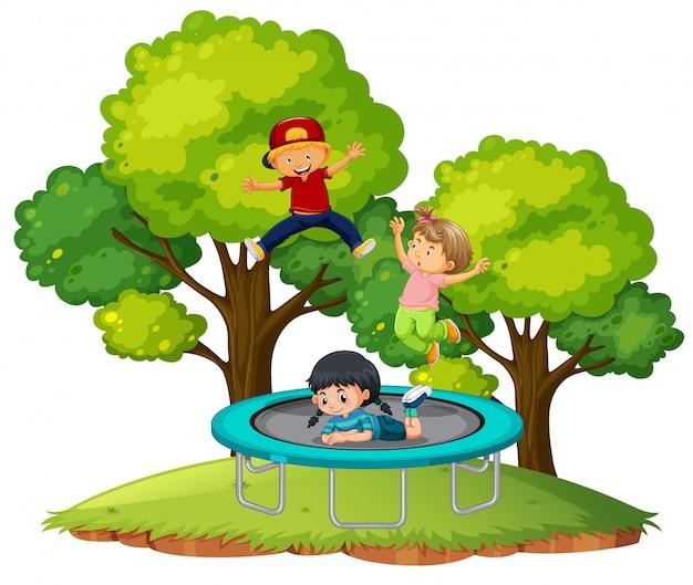 Kinderen die op trampoline springen Premium Vector