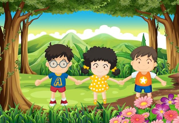 Kinderen houden hun handen in het bos Gratis Vector