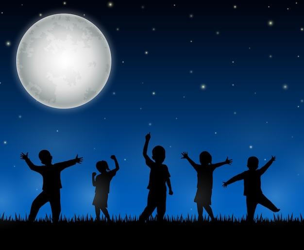 Kinderen silhouet op de nacht achtergrond Premium Vector