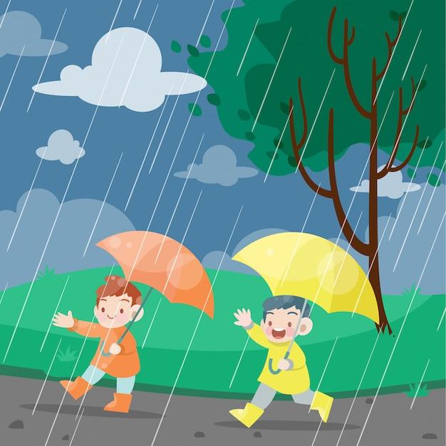 Kinderen spelen in regenachtige dag vectorillustratie Premium Vector