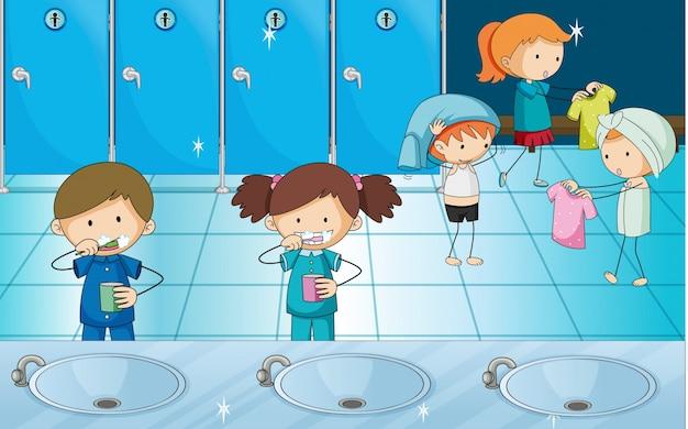 Kinderen tanden poetsen en kleding in kleedkamer krijgen Gratis Vector